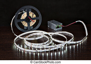 Glowing LED Strip Light on coil, close to power supply, on...