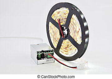 Illuminated LED diodes on reel tape, with adapter voltage...