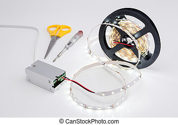 Coil luminous LED strip light and voltage transformer. -...