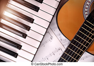 Piano and guitar with shine and sheet music background top -...