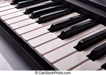 Electronic piano keyboard elevated view - Close-up of...