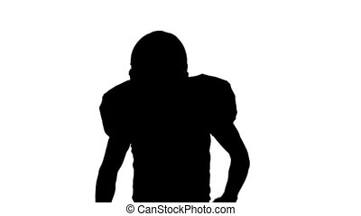 Football player running with the ball and helmet. Slow motion. White backgraund