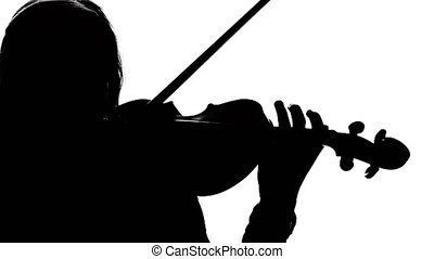 Girl volinist playing the fiddle. Close-up. Silhouette -...