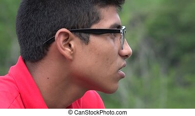 Hispanic Teen Boy Talking And Wearing Glasses