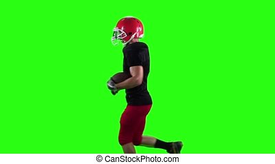 Athlete runs and throws the ball. Slow motion. Green screen...