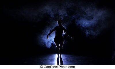 Dancing girl samba in studio, silhouette. Blue backlight -...