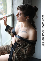 Young Woman in Sexy Silk Rober - Photo of a young woman with...