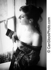 Young Woman in Sexy Silk Robe - Black and white photo of a...