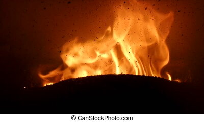 Burnt Pellets Residue On Stove Window - Closeup of flame...