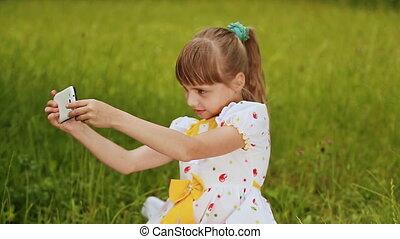 Little girl makes selfi