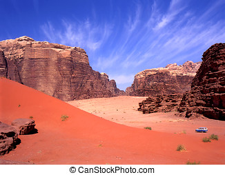 Four wheel drive in Wadi Rum, Jordan. Blue sky fades to red...