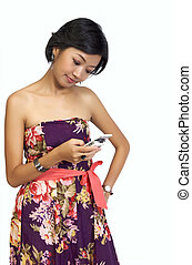 Woman Looking At Her Handphone - Pretty Asian Woman looking...