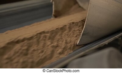 Industry. View of sand moves on conveyor belt - Brick...