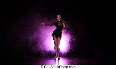Dancer in studio with purple lighting, a dark background -...