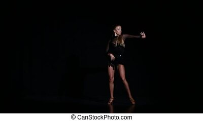 Professional beautiful dancer rumba in a studio on a dark...