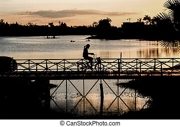 housewife going to shopping with bicycle - silhouette house...