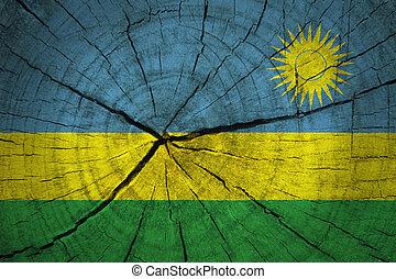 Rwanda Flag on old wood background