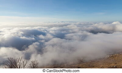 flying above the clouds - flight over the clouds before...