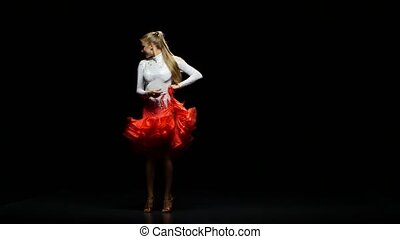 Girl dancing rumba in a studio on a dark background - Girl...