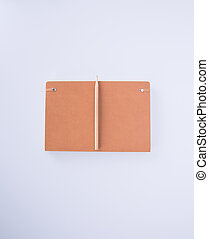 notebook or leather diary and pencil on the blackground. -...