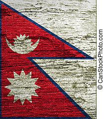 Nepal Flag painted on grunge wood background