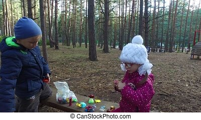 Boy and girl playing with toys. Children kindled a their...