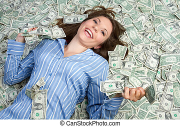 Money Woman - Beautiful woman laying in money