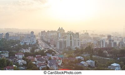 Sunset over the city of Alma-Ata. Kazakhstan. Zoom. Time...
