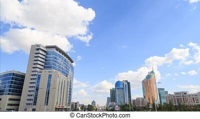 Clouds over the skyscrapers. Kunaev Avenue, Astana, Kazakhstan. Time Lapse