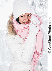Beautiful young woman outdoors in winter