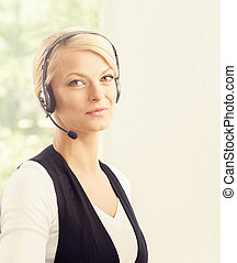 Portrait of a young blond customer support operator -...