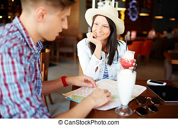 Tourists in love - Young woman looking affectionately at her...