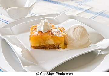 Tarte Tatin, delicious French dessert with puff pastry,...