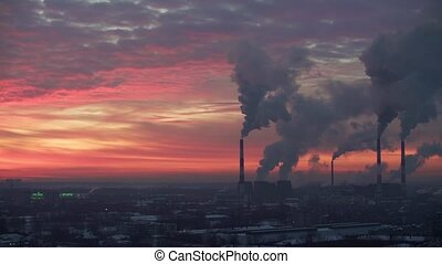 Air pollution. Power plant at sunset