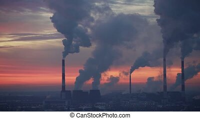 Air pollution. Power plant at sunset time lapse