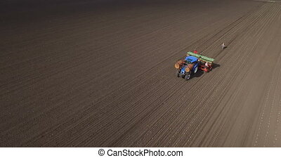 Planting cabbage seedling. - Aerial of tractor on harvest...