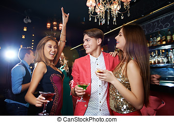 Luxury night life - Young stylish friends having a good time...