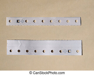 Perforated paper strips used in tabulated paper for computer...