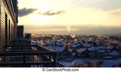Iced balconies, trees and snowy roofs, sunset timelapse -...