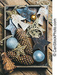 Christmas tree toy stars, balls and garland in wooden box -...