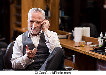 Senior business sitting man talking on mobile phone -...