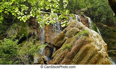 Waterfall Silver stream among the Crimean mountains. UltraHD...