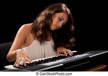 Young lady playing piano - Portrait of a beautiful woman...
