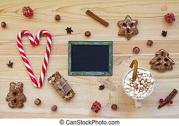 Christmas cookies and blackboard with festive decoration on...