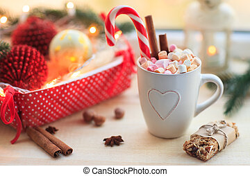 Christmas background with cup of chocolate, marshmallow and...