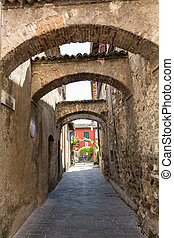 Picturesque narrow town street in Sirmione, Lake Garda...