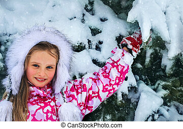 Girl winter clothes and warm hat with lot of snow. -...