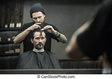 Preparing for haircut in barbershop
