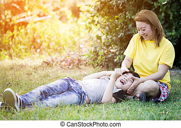 Happy asian mom with cute little boy at the park - Happy...