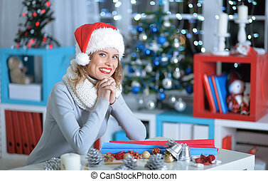 Young woman in Santa hat - Smiling young beautiful woman in...